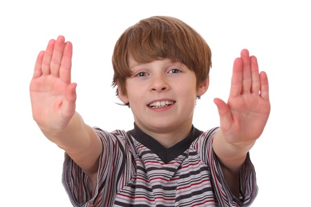 Portrait of a young boy making stop gesture on white background Stock Photo - 12065849