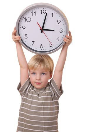 Portrait of a young boy holding a clock isolated on white background photo
