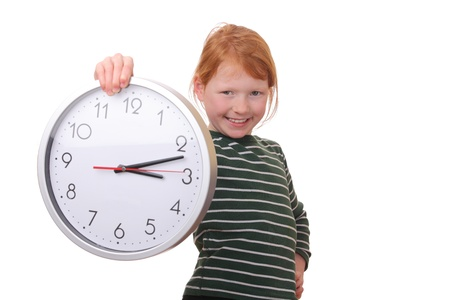 Portrait of a young girl holding a clock isolated on white background