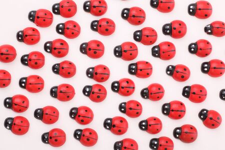 Lots of wooden ladybugs looking in one direction Stock Photo - 12620762