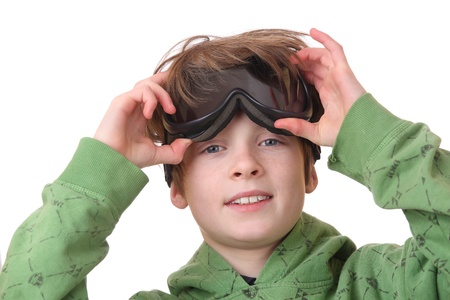 safety goggles: Portrait of a young boy wearing ski goggles isolated on white background