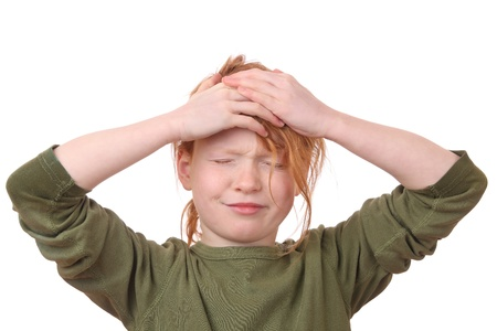 Portrait of a stressed young girl with her hands on her head