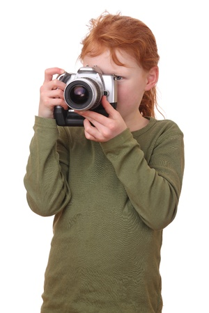 Portrait on a young girl with camera isolated on white background photo