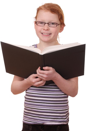 Portrait of a young girl reading a book isolated on white background photo