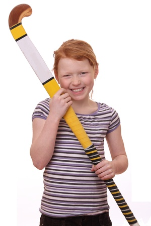 hockey stick: Portrait of ayoung girl holding a hockey stick isolated on white background