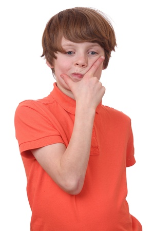 Portrait of a young boy with a pensive expression isolated on white background photo