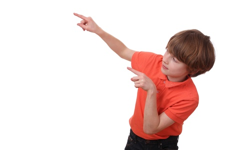 Portrait of a young pointing boy isolated on white background Stock Photo