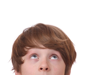 Portrait of a young teenage boy looking up on white background Stock Photo