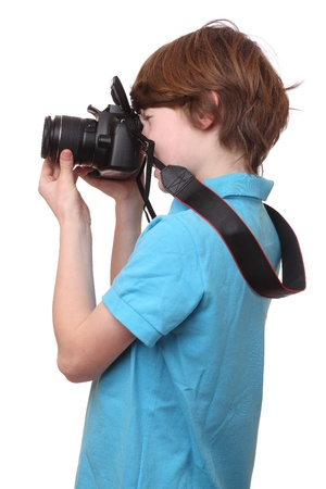 slr camera: Portrait of a young boy with camera isolated on white background