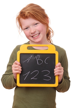 Portrait of a happy schoolgirl holding a blackboard photo