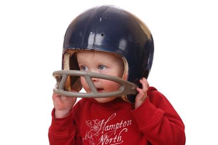 Boy with football helmet on white background