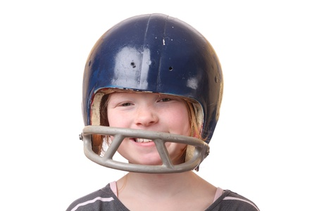 Girl with football helmet on white background photo
