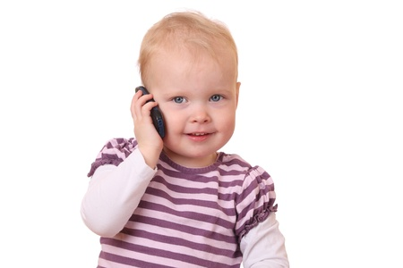 Young toddler with cell phone on white background Stock Photo - 13323334