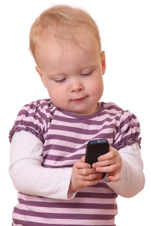 Young toddler with cell phone on white background photo