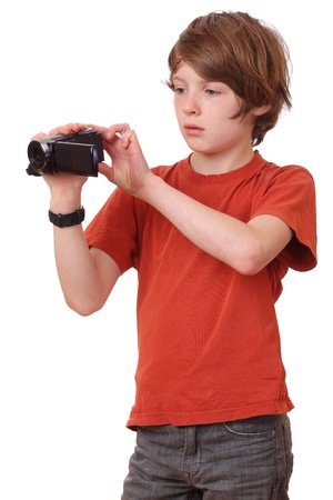 holiday movies: Young boy with camcorder on white background Stock Photo