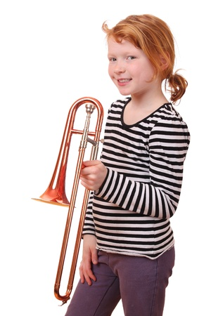 Young girl playing a trombone on white background Stock Photo - 13323404