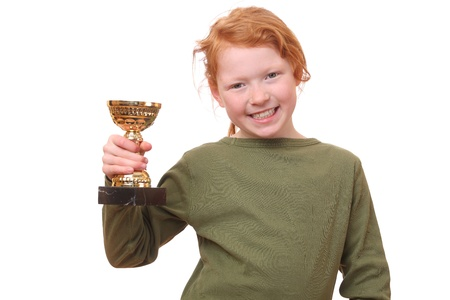 Proud young girl holding her trophy on white background photo