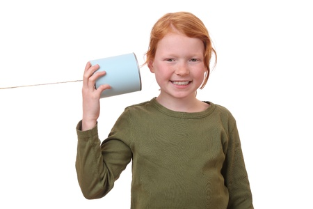 Young girl with a tin can telephone photo