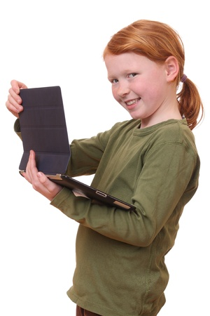 Happy young girl with tablet pc on white background photo