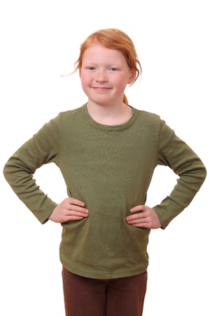 Smiling young girl with hands on hips on white background photo
