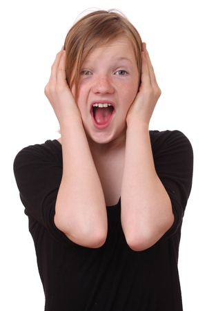 Screaming teenage girl on white background photo