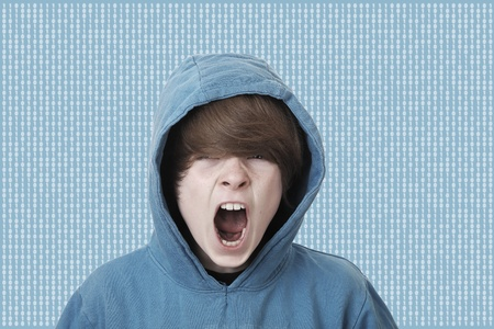 Screaming teenage boy caught in the matrix photo