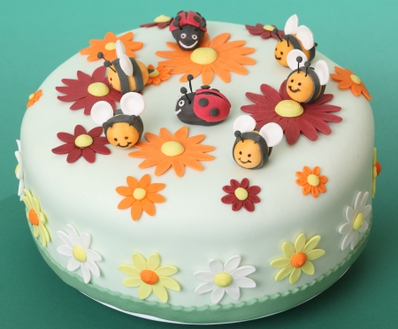 Birthday cake with flowers, sugar bees and ladybugs photo