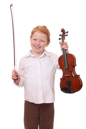 Portrait of a young girl holding a violin on white background photo