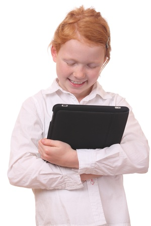 Portrait of a young girl with a tablet pc on white background photo