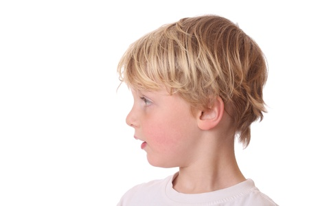 see side: Portrait of a young blond boy on white background Stock Photo