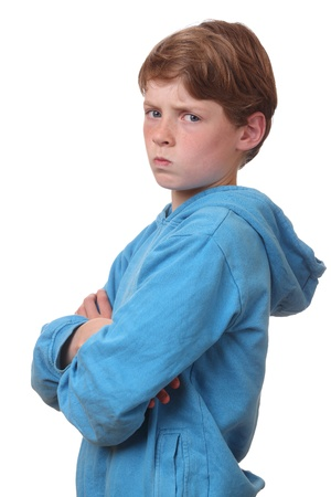 Portrait of an angry young boy on white background Stock Photo