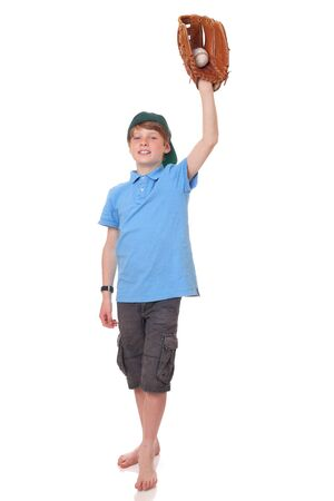 Portrait of a standing young baseball player on white background photo