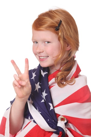Portrait of a young girl with an american flag on white background photo