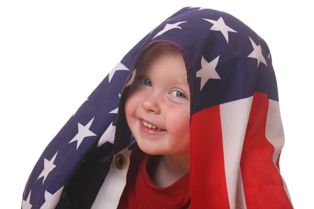 Portrait of a toddler with an american flag on white background