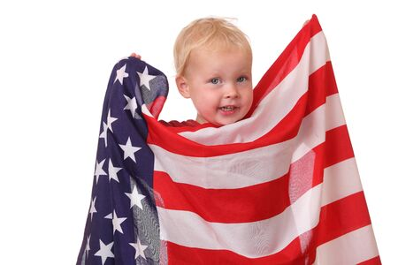 Portrait of a toddler with an american flag on white background photo