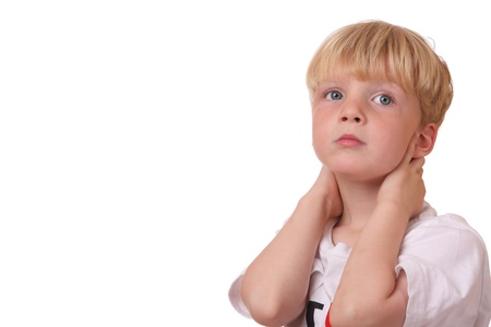 Portrait of a tired looking boy on white background photo
