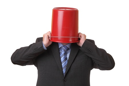 Businessman with a red bucket on his head  photo