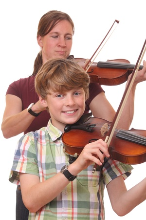 Woman and boy playing violin on white background Stock Photo