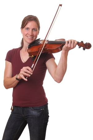 Portrait of a young woman playing violin on white background photo