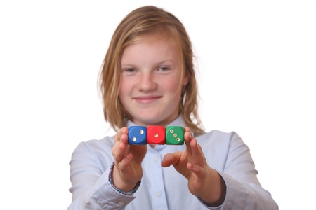Beautiful girl with gambling dices on white background photo