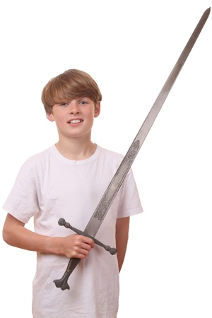 Young boy with a big sword on white background photo