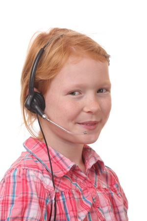 Young girl wearing a headset on white background Stock Photo