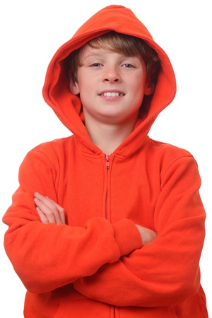 Young boy wearing an orange hoodie on white background Stock Photo