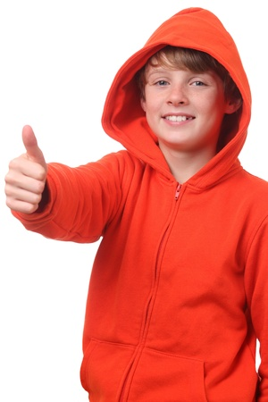 Young boy wearing a hoodie shows thumbs up on white background photo