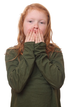Young red haired girl covers her mouth on white background Stock Photo - 16690007