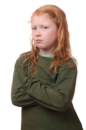 angry person: Portrait of a sad looking red haired girl on white background