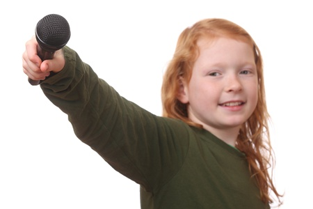 Young red haired girl with microphone on white background Stock Photo - 16690026