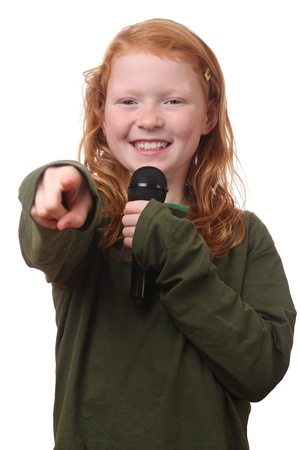 Young red haired girl with microphone on white background Stock Photo - 16690022