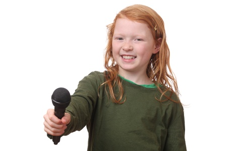 Young red haired girl with microphone on white background Stock Photo - 16690018