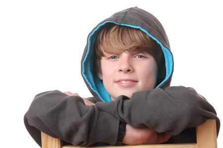 Portrait of a relaxed young boy wearing a hoodie Stock Photo